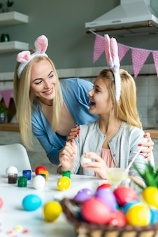Portrait of happy mother and daughter . happy family are preparing for easter. they wearing bunny ears.