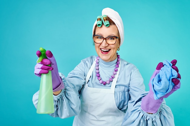 Portrait of happy old cleaning woman