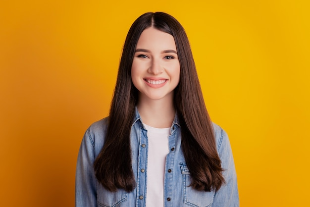 Portrait of happy positive girl toothy beaming smile on yellow wall