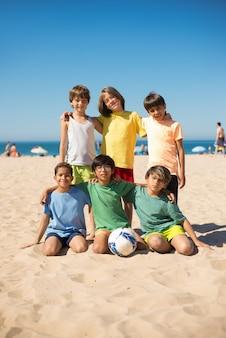 Portrait of happy preteen boy friends on beach