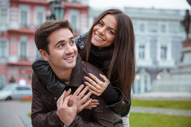 Portrait of a happy romantic couple traveling in old european city