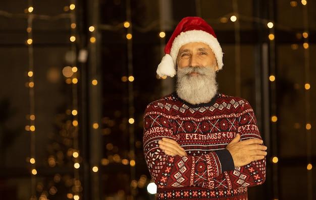 Portrait of happy santa claus at his room at home near christmas tree. xmas. new year.