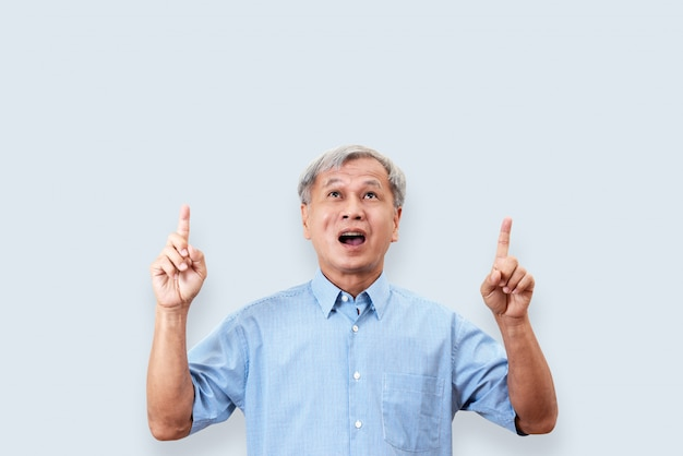 Portrait of happy senior asian man gesture or pointing hand and finger up