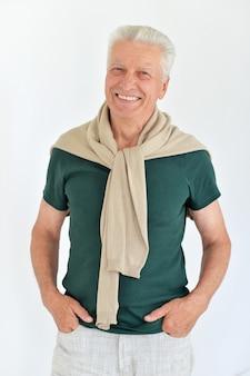 Portrait of a happy senior man on a white background