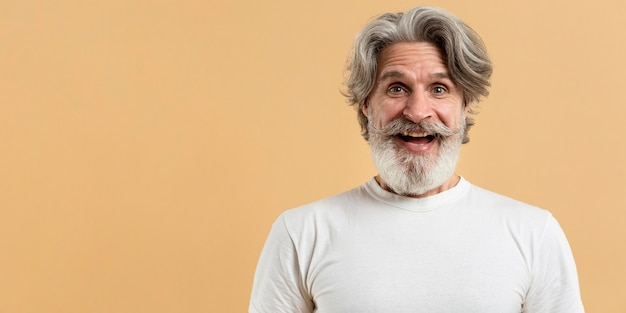 Portrait of happy senior man with copy-space