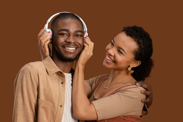 Portrait of happy and smiley couple with headphones