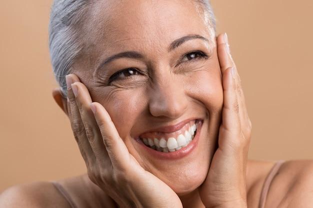 Portrait of happy smiley older woman