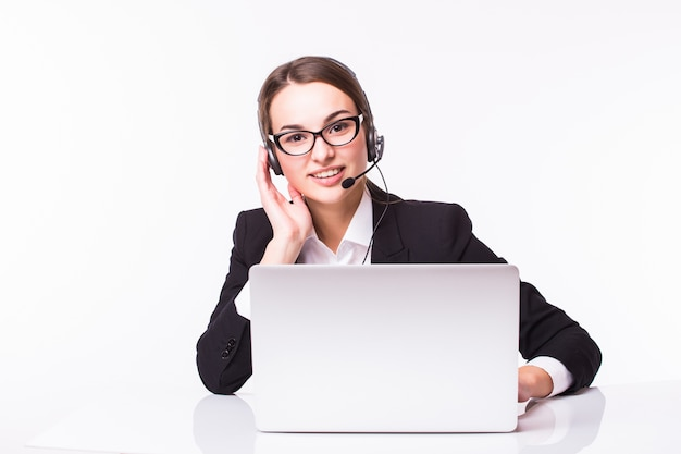Portrait of happy smiling cheerful beautiful young support phone operator in headset with laptop, isolated over white wall