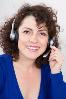 Portrait of happy smiling cheerful support phone operator in headset, isolated on white