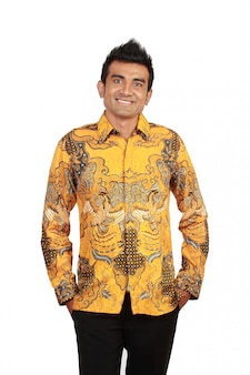Portrait of happy smiling man wearing batik