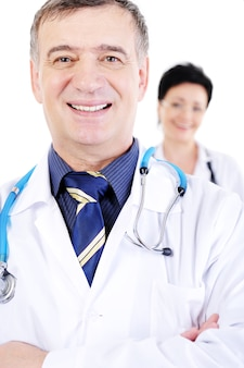 Portrait of happy smiling mature male doctor with female doctor