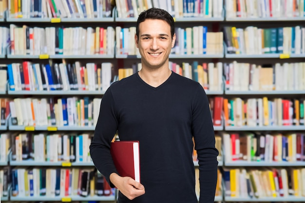 Portrait of a happy smiling student in a library