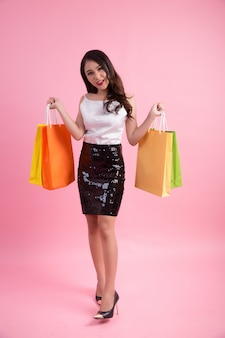 Portrait of happy smiling woman hold shopping bag