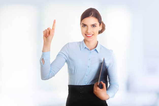 Portrait of happy smiling young beautiful businesswoman showing one thumbs up