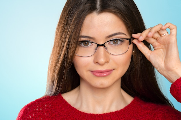 Portrait of happy smiling young business woman in glasses