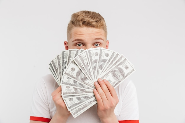 Portrait of a happy teenage boy holding money