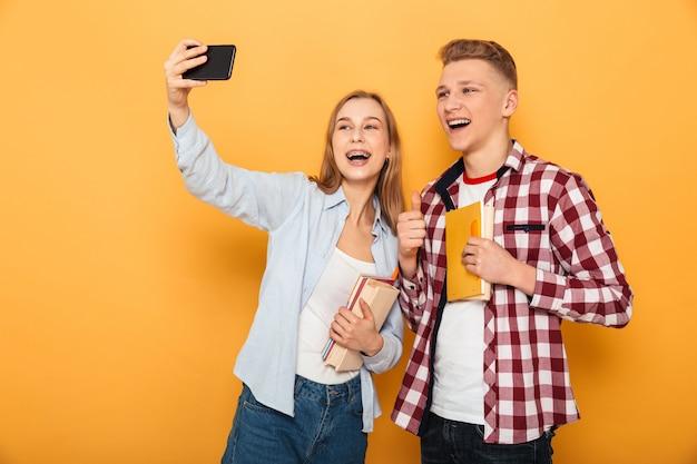 Portrait of a happy teenage school couple