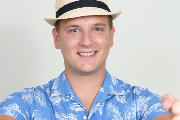 Portrait of happy tourist man with blond hair