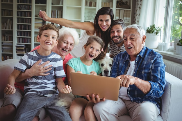 Portrait of happy  using laptop