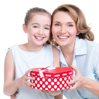 Portrait of happy  white mother and young daughter hold present - isolated