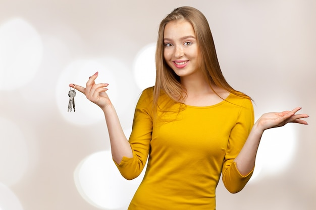 Portrait of happy woman holding keys
