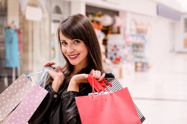Portrait of happy woman holding shopping bags
