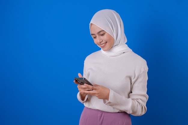 Portrait of a happy woman using mobile phone