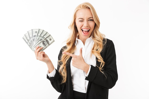 Portrait of happy woman wearing office clothing holding fan of money, isolated
