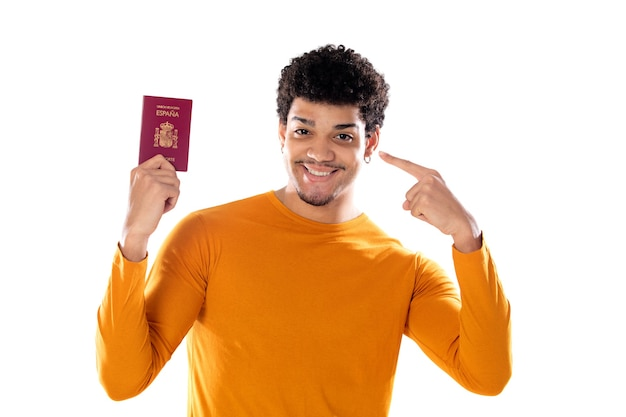 Portrait of happy young african tourist guy showing passport ready for vacation