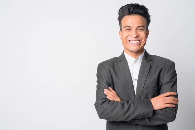 Portrait of happy young asian businessman in suit smiling with arms crossed