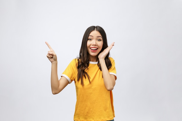 Portrait of happy young asian woman with finger point up