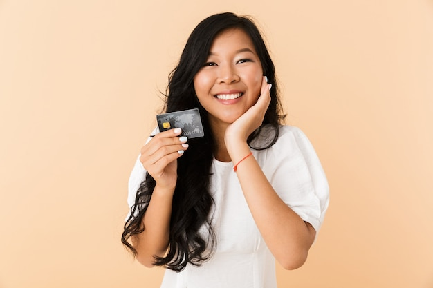 Portrait of a happy young asian woman