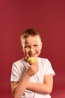 Portrait of happy young boy eating ice cream