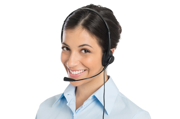 Portrait of happy young businesswoman wearing headset
