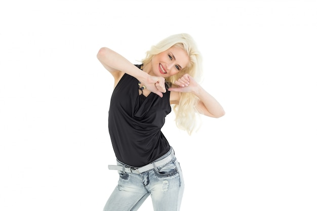 Portrait of happy young casual woman dancing