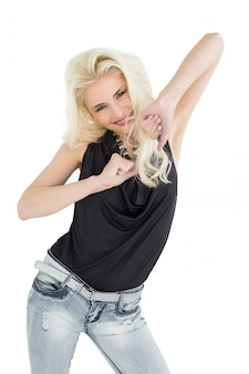 Portrait of a happy young casual woman dancing