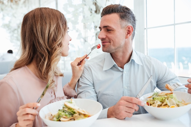 Portrait of a happy young couple having lunch