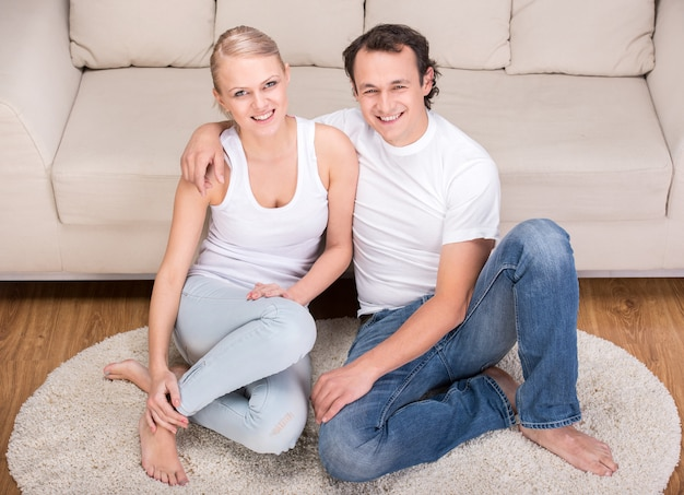 Portrait of a happy young couple at home.
