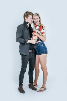 Portrait of happy young couple love together with flower