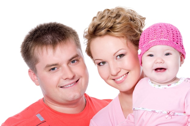 Portrait of happy young family with beautiful baby on