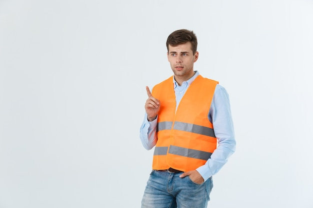 Portrait of happy young foreman with orange vest isolated over white background.
