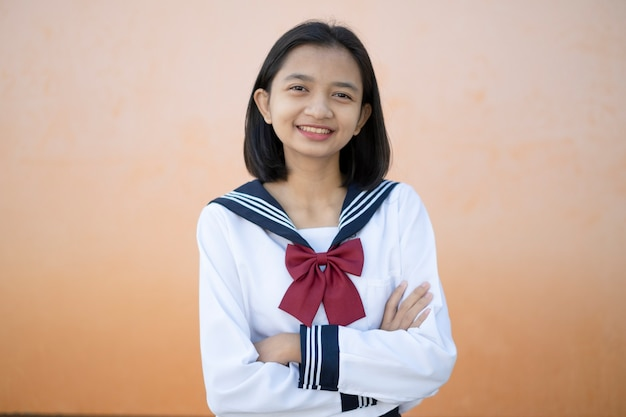 Portrait of happy young girl wearss a uniform at school