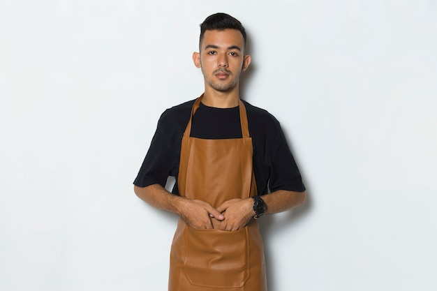Portrait happy young man barista waitress  isolated on white background