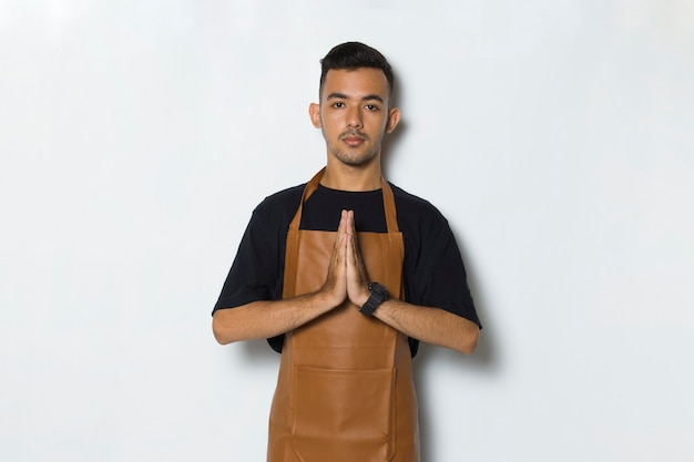 Portrait happy young man barista waitress welcoming guests gesture isolated on white background