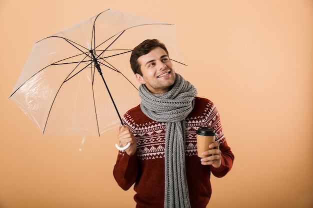 Portrait a happy young man dressed in sweater