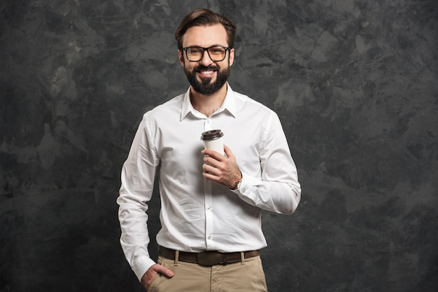 Portrait of a happy young man dressed white shirt