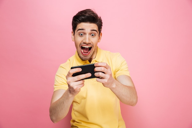 Portrait of a happy young man playing games