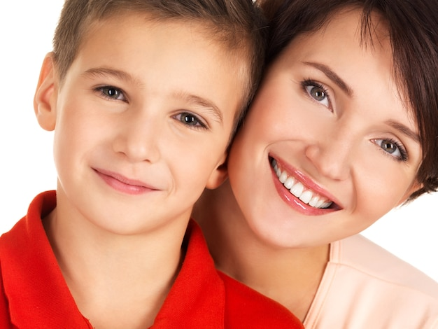 Portrait of a happy young mother with son 8 year old over white space