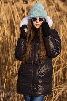 Portrait of happy young woman have a fun at beautiful sunny winter day