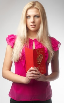 Portrait of happy young woman holding valentine card